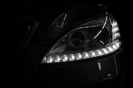Modern elegant car on black background. Фото со стока - 98968794