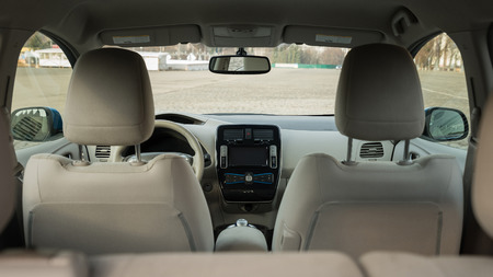 Modern electric car interior. View from back.