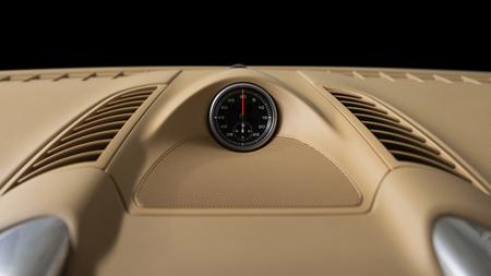 Stopwatch in dashboard of premium car. Interior detail. Фото со стока - 111763437