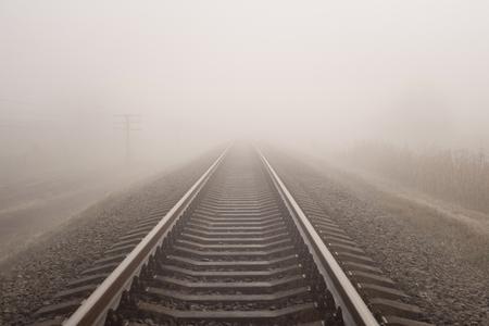 Foggy railway landscape. Horizontal photo. Фото со стока