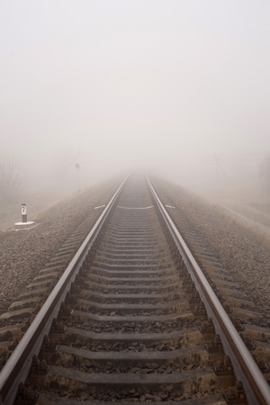 Foggy railway landscape. Vertical photo. Фото со стока - 111763440