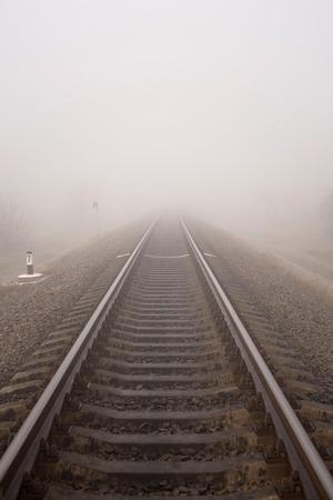 Foggy railway landscape. Vertical photo. Фото со стока