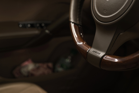 Airbag sign on steering wheel of car. Interior detail. Фото со стока - 121734595