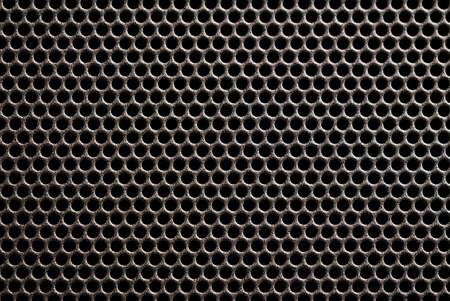Plastic grille background. Grid of audio amplifier.