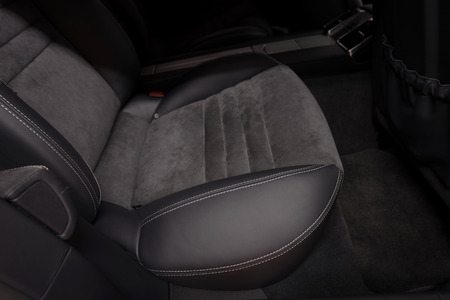 Back passenger leather seats in modern car. Interior detail. Фото со стока