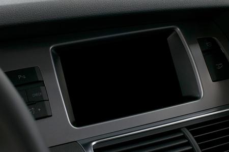 Screen multimedia system in car dashboard. Interior detail.