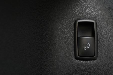 Car trunk open closing button. Interior detail.