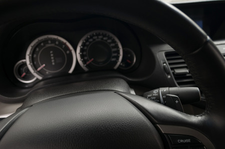 Manual gear changing paddle on car's steering wheel. Interior detail. Фото со стока - 121734624