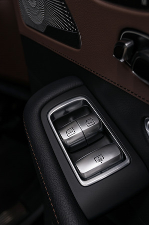 Window control buttons in business car. Interior details.