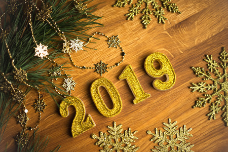 Happy New Year 2019 background. Symbol from number 2019 on wood. Фото со стока - 121735079