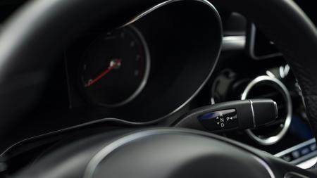 Car interior detail. Automatic transmission gear lever. Фото со стока