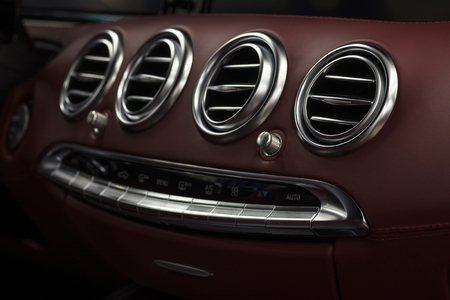 Luxury car interior details. Leather dashboard with air condition. Фото со стока - 121735086