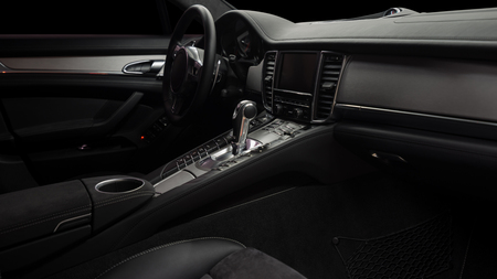 Modern car inside. Control panel and automatic transmission background.