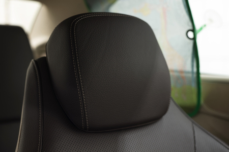 Leather headrest in modern car. Фото со стока - 121735099
