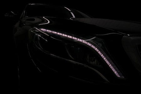 Black modern car on black background. Фото со стока - 121735103