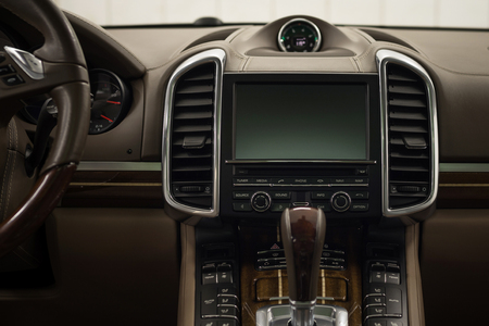 Modern car dashboard. Screen multimedia. Interior detail.