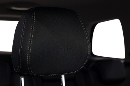 Car leather headrest. Interior detail. Фото со стока