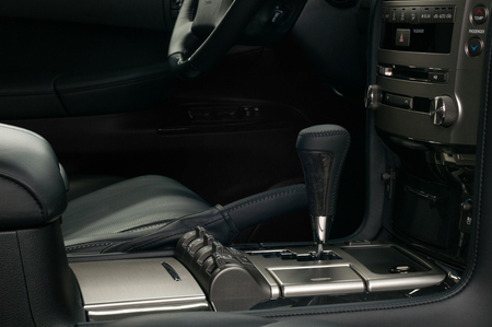 Modern car interior detail. Automatic transmission gear shift.