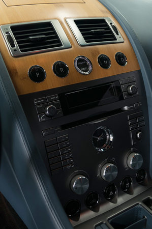 Panel of modern sport car. Interior detail. Vertical photo.