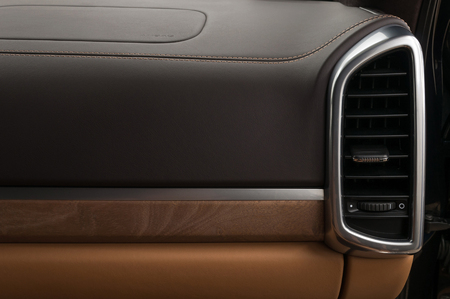 Car dashboard. Air conditioning system and airbag panel.