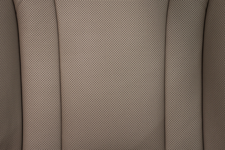 Leather background. Modern car perforated seat. Interior detail. Banco de Imagens