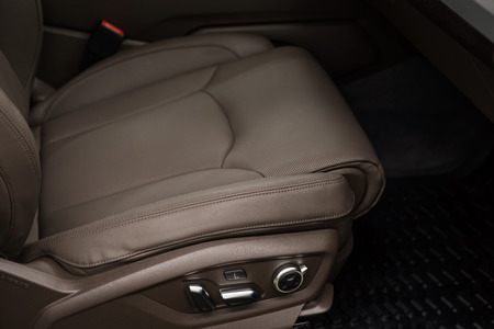 Modern car interior background. Passenger leather seat.