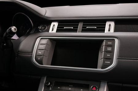 Panel of modern car with screen multimedia system. Auto interior detail.