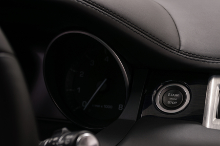 Car engine start stop button. Interior detail.