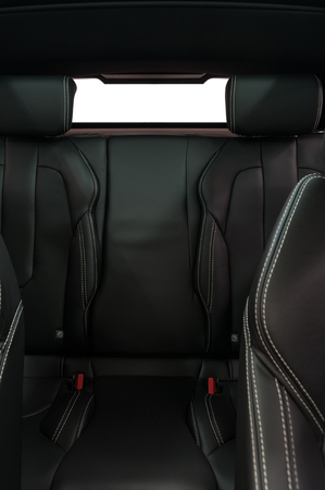 Leather back passenger seats in modern car. Vertical photo. Stockfoto