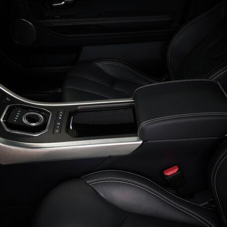 Modern car interior detail. Automatic transmission gear shift.