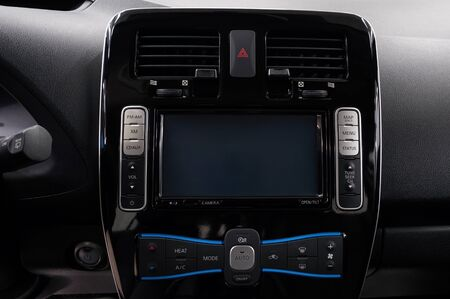 Modern car dashboard with screen multimedia. Interior detail. Фото со стока