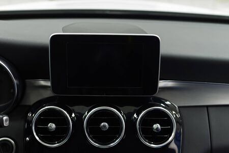 Modern car dashboard with screen multimedia system. Interior detail.