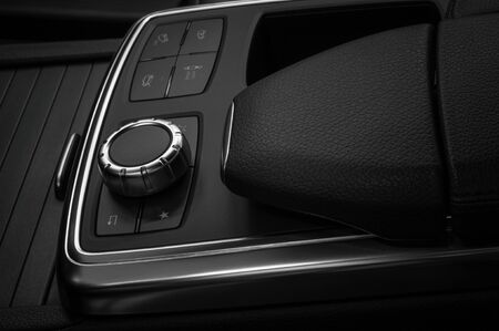 Dashboard control buttons in modern car. Interior background.