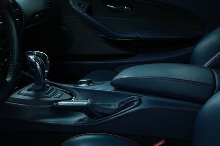 Modern sport car interior detail. Automatic transmission gear shift. Фото со стока