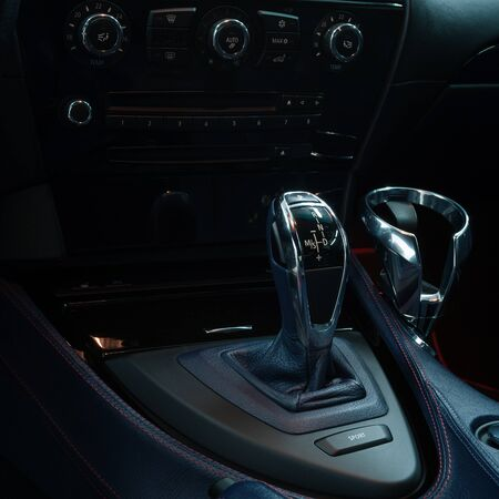 Control panel with automatic transmission in car. Interior detail.