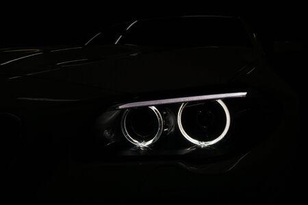 Lights reflections on the dark modern car.