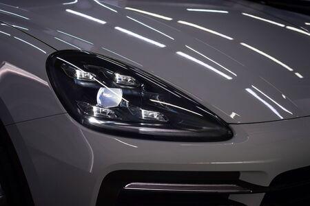 New modern car headlights. Exterior detail.
