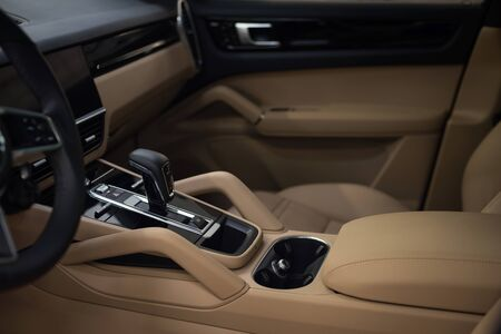 Automatic transmission in modern new car. Interior detail.