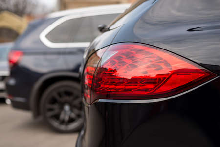 Detail on the rear light of modern car. Фото со стока
