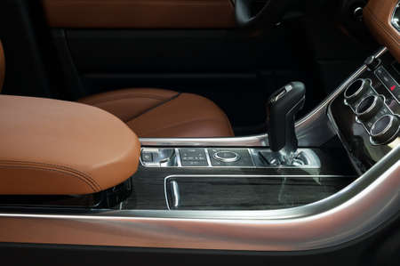 Automatic transmission gear shift. Modern car interior. Фото со стока