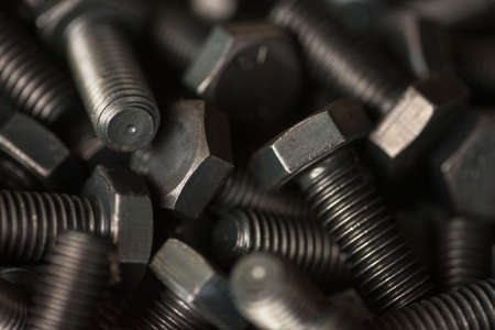 Metal bolts. Industrial background. Horizontal photo.