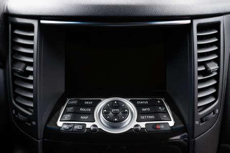 New modern car dashboard. Touch screen. Interior detail. Фото со стока