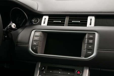 Modern car dashboard. Touch screen multimedia system. Interior detail.