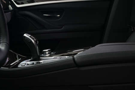 Business modern car interior background. Automatic transmission in modern luxury car. Interior detail.