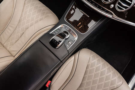 Modern luxury car interior detail. Horizontal photo.