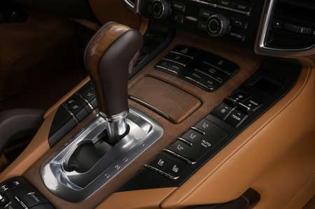 Sport modern car interior background. Automatic transmission in modern luxury car. Interior detail.
