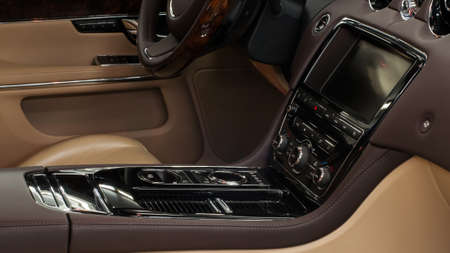 Modern car interior background. Panel with control buttons and screen.