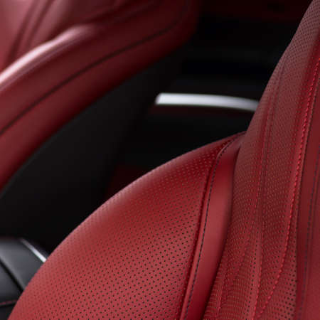 Leather material in modern car. Macro photo.