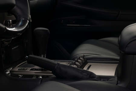 Modern car interior background. Automatic transmission. Panel with control buttons.