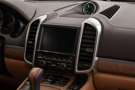Multimedia screen and control buttons in modern car. Interior detail.